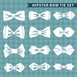 Several  white silhouettes of bow tie.Hipster fashion Stock Photos
