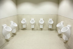 Several white urinals. clean toilet Stock Photo