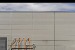 Several white ventilation vents are located next to the building.  stock photos