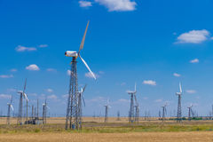 Several wind turbines on blue sky background Royalty Free Stock Images