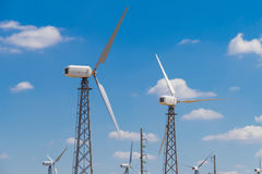Several wind turbines on blue sky background Royalty Free Stock Photo