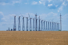 Several wind turbines on blue sky background Royalty Free Stock Image