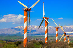 Several windmills and snow-covered Hermon Royalty Free Stock Photos