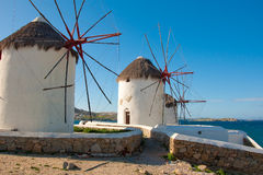 Several windmills walled stone fence on Mykonos. Royalty Free Stock Photography