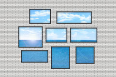 Several windows on a white brick wall with sea lan Royalty Free Stock Photos