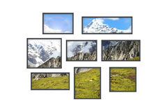 Several windows on a white wall with mountains landscape Stock Photos