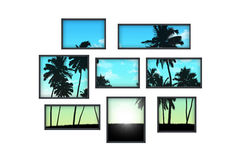 Several windows on a white wall with tropical landscape at sunri Stock Image