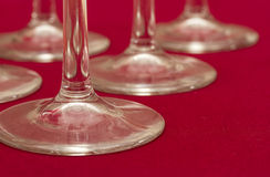 Several wine glasses on red Stock Photo