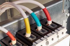 Several wires or cables are connected to the industrial circuit breaker royalty free stock images