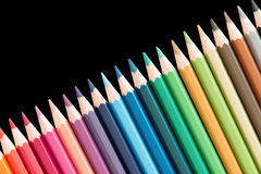 Several wooden colored pencils arranged royalty free stock photo