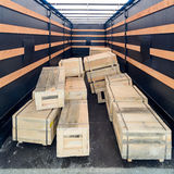 Several wooden crates inside the cargo semitrailer. Royalty Free Stock Images
