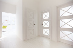 Several wooden doors with decorative glass inserts in corridor of modern apartment Stock Image