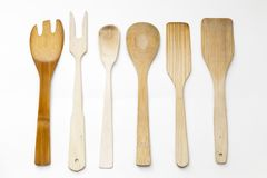 Wood kitchen utensils. Several wooden kitchen utensils spread out on a white surface Stock Photo