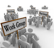Several Work Groups of Workers Divided Tasks. Many groups of workers gathered in teams around signs with the words Work Group to illustrate collaborative working Royalty Free Stock Photos