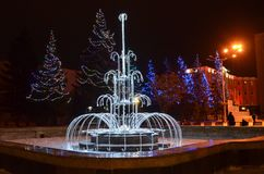 New year`s holidays. garlands fountain. For several years, on new year`s holidays, the municipal authorities of a small Siberian town so decorated with garlands royalty free stock images