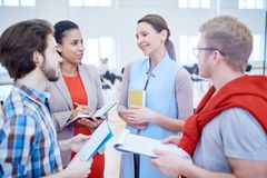 After conference. Several young managers discussing reports of speakers and their opinions after conference royalty free stock image