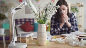 Severe allergic reaction to the flowers,a young woman sneeze into disposable handkerchiefs. Severe allergic reaction to the flowers,a young woman in shirt and stock video