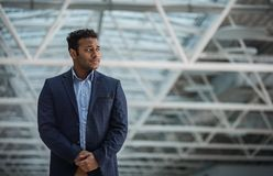 Severe businessman is expressing concern. Lost in thoughts. Young serious entrepreneur is standing and looking aside thoughtfully. Copy space in the right side Royalty Free Stock Photography