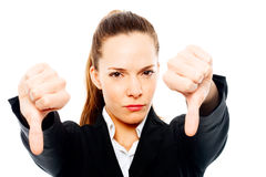 Severe businesswoman with thumb down on. White background studio Royalty Free Stock Image