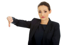 Severe businesswoman with thumb down. Royalty Free Stock Image