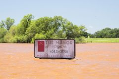 Severe Flooding in Oklahoma with tall sign under water royalty free stock photography