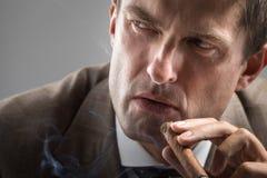 Severe gaze of elegant smoker. Severe gaze of elegant adult smoker Stock Photo