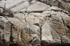 Severe granite rocks on the sea coast Stock Photo