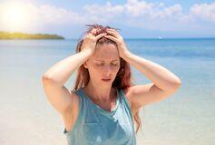Free Severe Headache On Tropic Seaside During Vacation. Bright Sun Negative Impact Sunstroke Stock Photo - 189244810