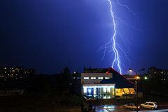 Severe lightning storm over a city buildings Royalty Free Stock Photos