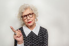 Severe mature woman expressing her discontent royalty free stock photography