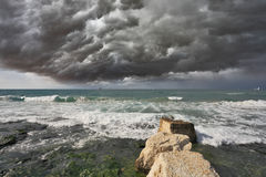 Severe storm cloud over the surf Royalty Free Stock Photography