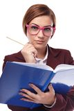 Severe teacher cheching the class book Royalty Free Stock Image