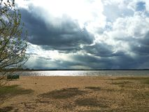 Severe thunderclouds over the sandy beach of Lake Seliger. royalty free stock photos