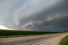 A severe thunderstorm accompanied by a menacing shelf cloud approaches. Royalty Free Stock Photos