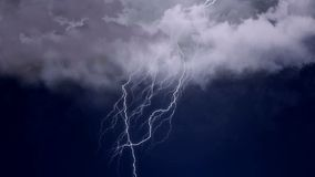 Severe thunderstorm and intense lightning in the night sky, meteorology, climate. Stock footage royalty free stock photo