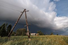 Severe thunderstorm moving in. Danger of stay near the power line. Severe thunderstorm moving in. 5 minutes before squall. Danger of stay near the power line Royalty Free Stock Photo