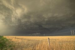 Ominous looking thunderstorm over the fields in northern Texas. Severe warned storm over the wide open plains of northern Texas stock photo