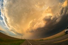 Fisheye view of a Great Plains supercell thunderstorm over the road in the northern Texas panhandle. Severe warned thunderstorm in northern Texas. Photographed stock photo