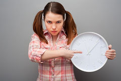 Severe woman pointing at clock Stock Photos