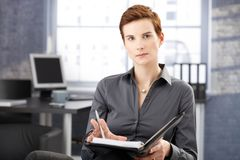 Severe young businesswoman at work Royalty Free Stock Photography