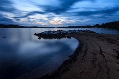 Severn River at last light. Long exposure of the Severn River in Maryland about twenty minutes after sunset. The long exposure shows in the smooth water and stock photography