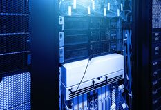 Severs computer in rack at the large data center under blue neon light. Network and technology futuristic concept royalty free stock images