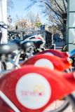 SEVICI, a public bicycle rental service in Seville, Spain. SEVILLE, ES - MARCH 8, 2017: SEVICI is a public bicycle rental service implemented in Seville in July stock photography