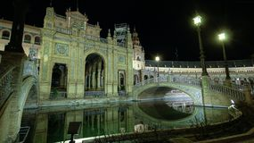 Architectural details of the buildings and brdges, at night, of Plaza de Espana in Seville, Spain royalty free stock images