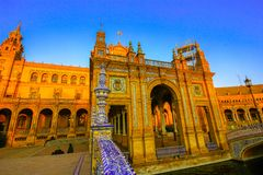 Architectural details of the buildings and brdges of Plaza de Espana in Seville, Spain, with tourists stock photo