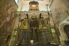In the Sevilla Cathedral, Southern Spain, is the mausoleum-monument and ornate tomb of Christopher Columbus where four heralds dre. Ssed in full court mourning royalty free stock photos