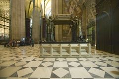 In the Sevilla Cathedral, Southern Spain, is the mausoleum-monument and ornate tomb of Christopher Columbus where four heralds dre Stock Photography