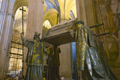 In the Sevilla Cathedral, Southern Spain, is the mausoleum-monument and ornate tomb of Christopher Columbus where four heralds dre Royalty Free Stock Images