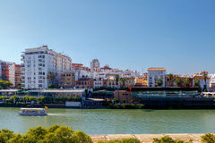 Sevilla. City embankment along the Guadalquivir. View of urban embankment in Seville along the Guadalquivir river by day. Spain. Andalusia royalty free stock photo