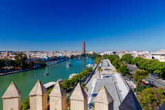 Sevilla. City embankment along the Guadalquivir. View of urban embankment in Seville along the Guadalquivir river by day. Spain. Andalusia stock images